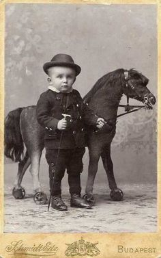 Old Fashioned Kids With Large Toy Horses | sweet juniper inspiration