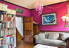 Pink for the living room? Sherwin Williams Forward Fuchsia. Decorating with natural wood trim sucks... but this does not suck.