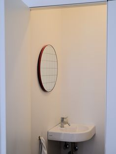 Bespoke round red frame mirror with a red green created for a client in Brooklyn, NYC .