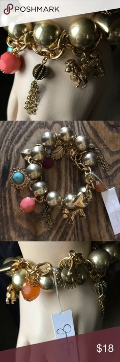 Jessica Simpson Charm Bracelet, stretchy fun Very cute stretch goldtone ball chain bracelet with loads of charms. Both metal and plastic charms, including a dog, feather, heart, faceted faux gems. Jessica Simpson Jewelry Bracelets