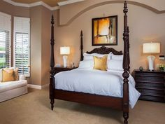 High ceilings, neutral bedroom and four poster bed.