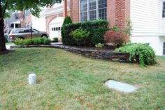 dry stack flagstone for foundation plantings where the yard slopes