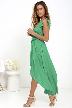 Fun-filled days are fated to follow the arrival of the Merriment to Be Green High-Low Dress! Lightweight woven rayon shapes a surplice bodice with an alluring V-neckline (with modesty snap). Ruffled detail accents the shoulders, neckline, and back, while a fluttering high-low skirt falls from an elastic waistline with tying sash.