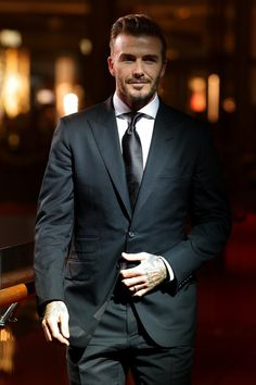 David Beckham wearing Tom Ford Peak Lapel Suit, Tom Ford Classic Fit High Collar Stand Barrel Cuff Shirt, Rolex Submariner Date Watch