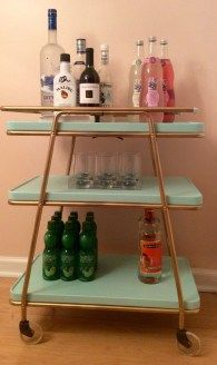 Retro Cosco Bar Cart After we painted our dining room pink, it suddenly transformed into a fun, slightly retro space. It is missing art, of course, but it also seemed to be missing an important retro element… a b… Vintage Bedroom Decor, Retro Home Decor, Vintage Decor, 1950s Decor, Retro Furniture, Mid Century Modern Furniture, Bar Furniture, Kitchen Furniture, Furniture Removal