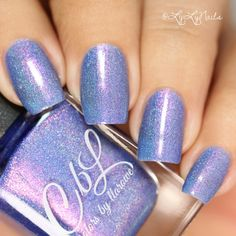 Colors by llarowe Summer 2016 - Shiny Happy People is a periwinkle blue scattered holographic with a purple sheen and shimmer that shifts pink to copper to green. This polish glows and is a true chameleon! Swatch by @sahylyx3