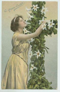 ANTIQUE EASTER POSTCARD - WOMAN CLUTCHING CROSS