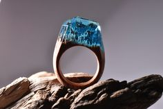 All our rings are handmade and unique. We use fresh wood, jewelry resin and beeswax. The rings are designed and made by Secret Wood exclusively....