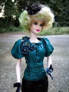 """Effie Trinket Repainted/Hair Restyled Barbie Doll in Teal Dress Costume from """"The Hunger Games"""" - by Morgan May @ Stardust Dolls - http://www.stardustdolls.com"""