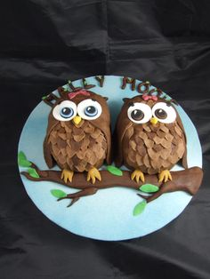 Chocolate owl cakes for twin girls' birthday. Chocolate cake, chocolate ganache covered in chocolate fondant, with a chocolate fondant branch for them to sit on.