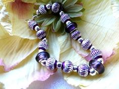 Purple Beaded Bracelet with silver and purple beads on a silver chain
