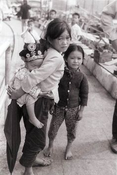 """photo of village children in Nha Trang, Vietnam, early There's quite a bit of emotion captured in their eyes here. The ""Fog of War"" sums it up pretty well, I think. Vietnam History, Vietnam War Photos, The Fog Of War, Patriotic Tattoos, Indochine, Sci Fi Shorts, Oral History, History Projects, Historical Pictures"