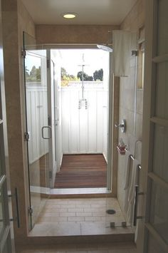 I am completely obsessed with the idea of an indoor/outdoor shower for our master bath similar to the design of one that we had at the Carneros Inn.