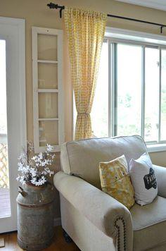Living Room decor - rustic farmhouse style. Old reclaimed window as wall decor.