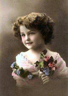 Meisje met gekleurde bloemen