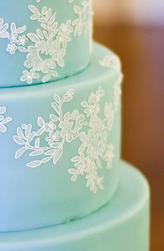 Something Blue - Classic lace piped over vintage turquoise made this cake elegant, but unexpected.  This cake is proof that taking a small risk with color can have a big payoff in style.  Town and Country Magazine agreed, they published it in their wedding edition.  Photo Credit:  Live and Love Studios