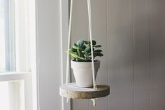 DIY a concrete hanging table this weekend.