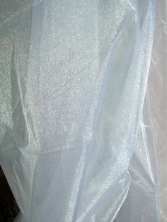 "Organza Fabric: Two Tone White Organza 54"" wide x 3 yards...it was too light for Elsa, but love the shimmer..."