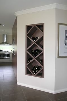 Got a blank wall near your kitchen or family room? How about a built-in wine rack like this one from an Eden Brae display home?