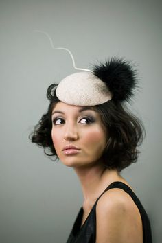 Tweed cocktail hat with faux pom by Maggie Mowbray Millinery, £120, because who doesn't love a faux pom?