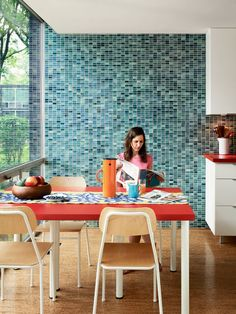 Lafayette Park resident Keira Alexander sits in her renovated kitchen. The wall tile is by Vitra. See the other rooms in her townhouse here. Photo by Raimund Koch. This originally appeared in Mies van der Rohe, Lafayette Park. Bauhaus, Mid-century Modern, Modern Design, Modern Homes, Contemporary, Kitchen Decor, Kitchen Design, Kitchen Ideas, Lafayette Park