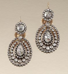 PAIR OF DIAMOND EAR PENDANTS, 1800S Each surmount centring on a foil-back rose-cut diamond within surrounds of similarly-cut stones, suspending a pear-shaped diamond-set swing centre dressed by two concentric frames embellished with rose-cut stones, assay marks, drops and frames detachable, later fitted case by Holmes, 29, Old Bond street, London, W.1.