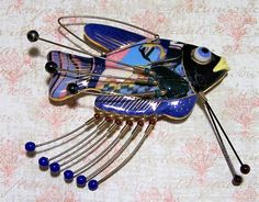 Authentic Jewelry 10 Cynthia Chuang fish brooch Hand painted glaze, with glass eye, long wire extensions each capped with a bead Just fish is 1 5/8 x 3 inches Including wire extensions pin is 3 3/8 x 3 Signed on back Jewelry 10 Very good vintage condition, shows no wear International buyers welcome, overcharges are refunded Flat rate Priority shipping is optional   Want to see more vintage pins? Click here: https://www.etsy.com/your/shops/GretelsTreasures&#x...