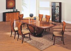 Coffee and dark brown color finished dining room set. The Dining Room Set will make connection to the past with its chic metro styling and warm Art Deco feel. It will also infuse your dining room with the warm and relaxing flair and also set a relaxed ambiance for enjoyable dinner parties and intima...