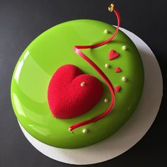 No photo description available. Zumbo's Just Desserts, Elegant Desserts, Fancy Desserts, Mirror Glaze Cake, Mirror Cakes, Grinch Cake, Christmas Cake Designs, Single Layer Cakes, Colorful Cakes