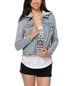 For a basic way to stay warm after a day at the beach grab the Light Wash Hooded denim jacket from Thread and Supply. This denim vest features heather grey fleece sleeves as well as a detachable drawstring hood that looks great with all your summer outfit