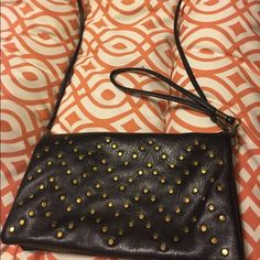 New black crossbody urban outfitters bag purse New crossbody bag from urban outfitters. Cute faux leather w gold studs in a chevron print. Great for going out! Lots of pockets and slots. Can also use as a wristlet! Urban Outfitters Bags Crossbody Bags