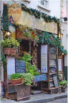 La poulbot, Le Montmarte, Paris. The restaurant was named after Francisque Poulbot (b. 1879), an illustrator of Parisian street children.