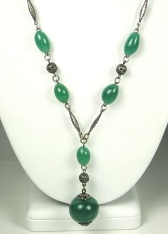 30% off sale until 11/23/15 After Christmas Sale 25% off! A silver and green glass necklace. The necklace chain is made up of oval shaped green glass beads that are attached to flattened silver diamon... #dangle #balls #filigree #present #woj #judysgems2 #classic #teamlove