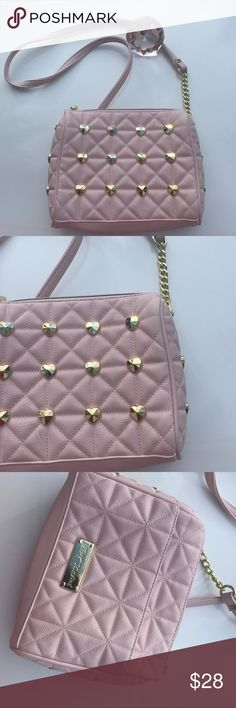 🌸Betsy Johnson dainty handbag🌸 ❣️This is a very beautiful gold chains on long strap , gold accent studded design blush pink very dainty handbag❣️mint condition..use no more than 2xs  view pictures to see condition. Lots and lots of compliments for sure. Betsey Johnson Bags Shoulder Bags
