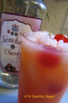 Popped Cherry      (1 c. ice  1 oz. maraschino cherry juice  2 oz. cherry vodka  4 oz. orange juice  3 maraschino cherries)