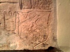 An unknown prisoner carved a likeness of Anne's Falcon badge, fittingly without the crown and sceptre, but mounted atop the rose bush emblem of the Tudors, in the wall of the Beauchamp Tower in the Tower of London. This tower provided an excellent view of Tower Green, where Anne was executed.