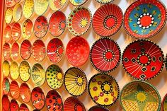 Colorful plates from The Potters Workshop - made on the premises, and innovative Xhosa artists painting the functional, highly sophisticated decorative ceramics.