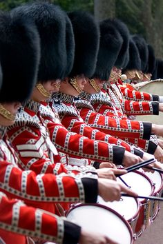 Foot Guards - are infantry regiments of the Household Division, recognisable by the bearskin worn on their heads. They are responsible for the military security of the sovereign. These are the Coldstream Guards Corps. of Drums from the Massed Bands of the Foot Guards, marching back to Buckingham Palace after 'Trooping the Colour'.
