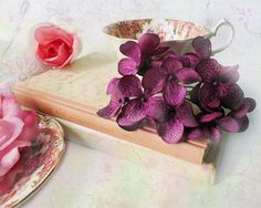 Tea Time is the sweetest arrangement of pink and purple flowers, a fine china tea cup, and a beautiful old book. The added texture enhances the soft, dreamy, romantic, and vintage feel. MEMBER - briberrie