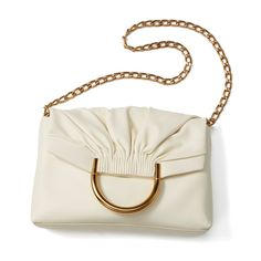 Made of buttery-soft faux-leather, with cool pleating details and gold hardware, this shoulder bag balances perfectly between modern and classic. It's got pocke