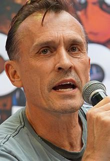 """Robert Lyle Knepper, Freemont, Ohio,  (born July 8, 1959) is an American actor best known for his role as Theodore """"T-Bag"""" Bagwell in the FOX drama series Prison Break from 2005 to 2009 and has also appeared in films such as Good Night, and Good Luck, Hitman and Transporter 3. Knepper joined the cast of Heroes in 2009 for its final season as Samuel Sullivan, and he played Sid Rothman in the neo-noir television series Mob City in 2013."""