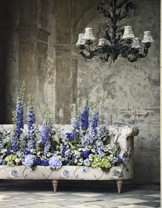 www.houseandgarden.co.uk. House & Garden Magazine: New Fabric Collections - Oct 2013 issue. For stockist information visit: http://www.houseandgarden.co.uk/design-interiors/2013/october/new-collections-swatch. Sofa, flowers, fabric, interior design, chandelier.