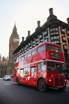 London Bus in the shadows of Queen Elizabeth II Tower (Big Ben).   > http://www.goldentours.com/london-tours