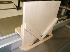 A spline cutting jig is used with your table saw to cut splines into the corner of picture frames or small boxes for add strength and decorative corners.