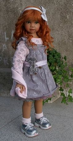 Angela Sutter Red head porcelain doll I can hardly believe some of these are dolls  !! So perfect.....