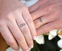 i kinda like the matching tattoos on your ring finger. the symbol of devotion still shows no matter what oliviamangrum