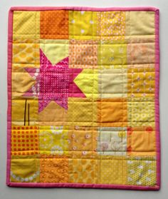 KAH says: yellow and a bright pink wonky star.