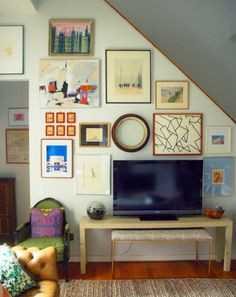 I like this gallery wall and how it goes around their television.  The gallery wall I am currently designing incorporates a flat screen TV.