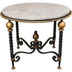 "Fine wrought iron and parcel gilt circular occasional/coffee table with marble top.  IN the manner of Gilbert Poillerat.  France. CIRCA: 1940 DIMENSIONS: 23"" h x 29"" d"