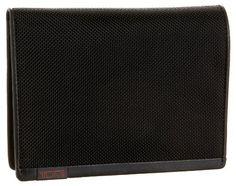"Tumi Alpha Passport Case,Black,one size TUMI. $98.00. Measures 5 1/2"" x 4 1/2"" x 1/2"". Made in China. Zipper closure. Nylon and leather. Nylon lining"